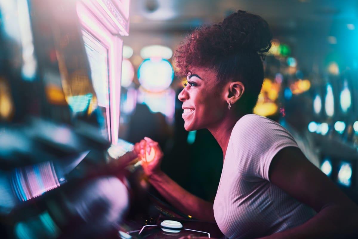 Woman playing on slot machine